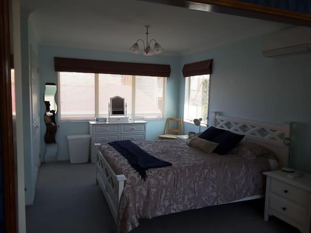 Upstairs studio queen size bedroom