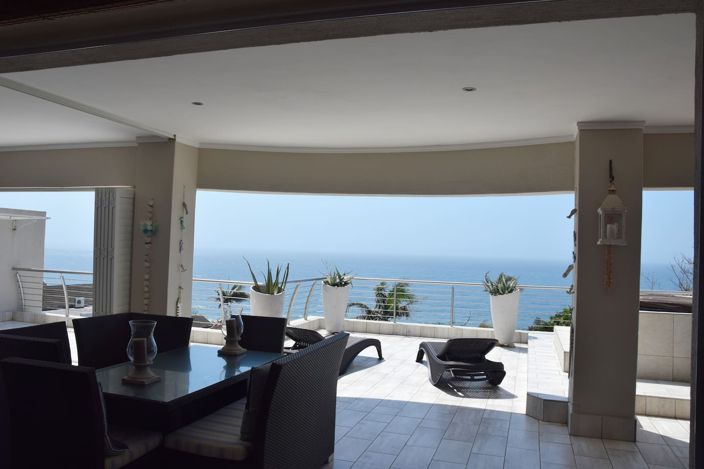 Luxuriously decorated, spacious apartment with stunning sea-views from very spacious patio; folding doors from the lounge and main bedroom onto patio with loungers, hammock, gas/weber barbeques and inviting jacuzzi (hot tub) set in a secure estate