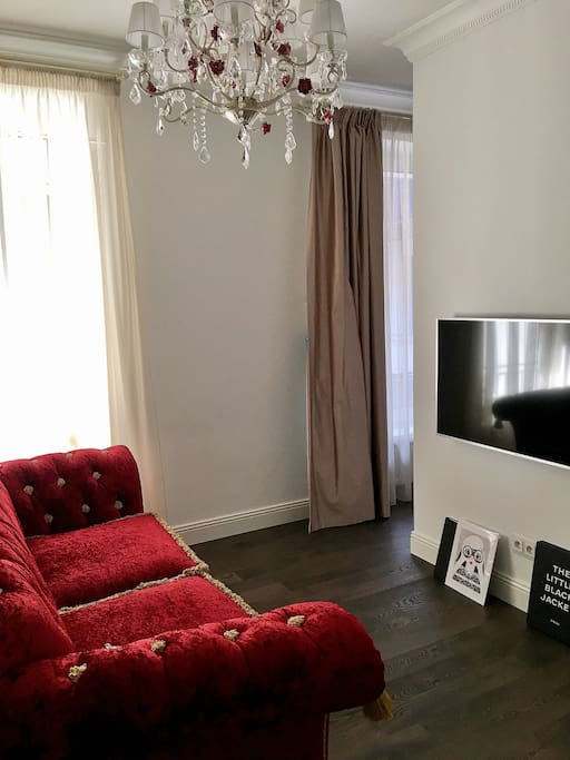 Living room with Bluetooth sound system and TV