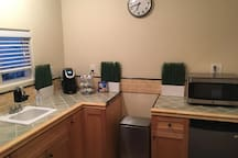 Full kitchenette with coffee machine and microwave