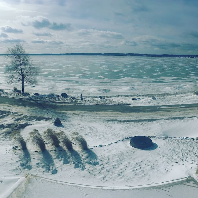 Panoramic lake view from master suite upper deck - winter