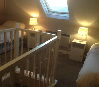 Light twin bed loft room with views; easy parking.