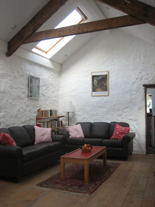The sitting room has two large west facing skylights which flood the room with natural light.
