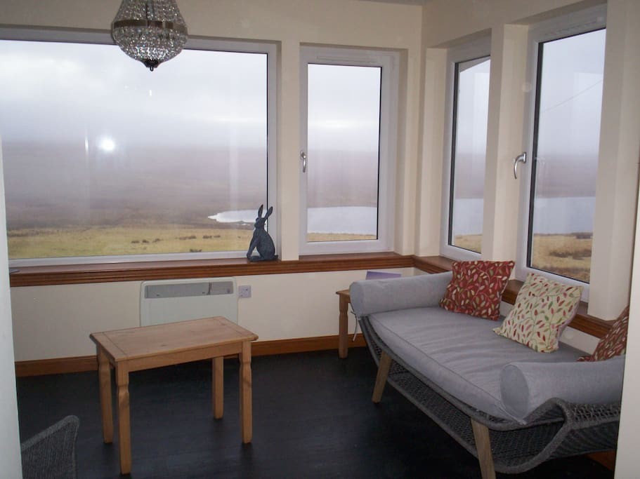Stunning views over the loch from the sunroom