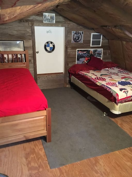 Upstairs sleeping area with double bed and 2 single mattresses that can make into 2 beds to sleep 4 people comfortably.