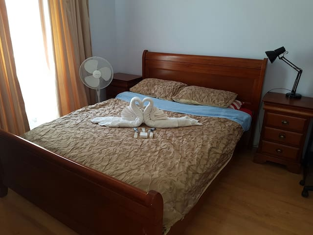 Bedroom with a queen bed - O'Sullivan Beach - Bed & Breakfast