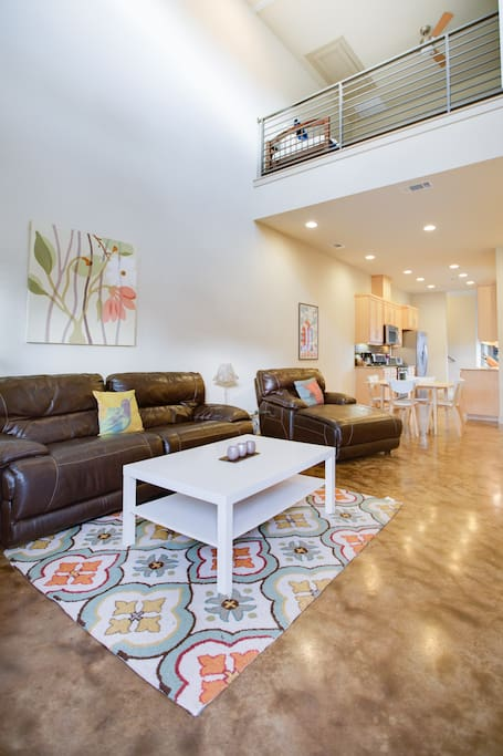 The living space is warm, open and inviting. It's a great space for relaxing and hanging out during your time in Austin.