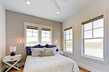 Tons of natural light in the 4th bedroom, which has a queen bed.