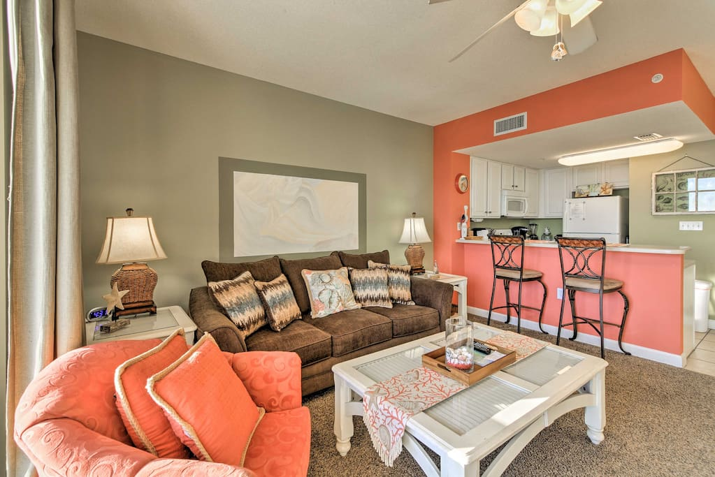 You'll feel right at home inside a living space full of seaside charm.