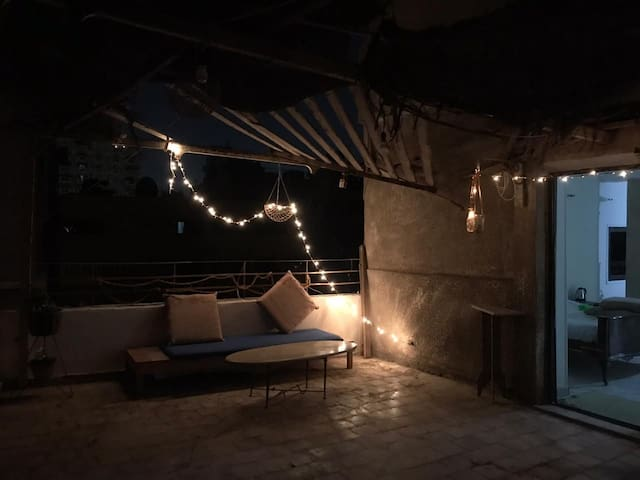 Rooftop view, cozy atmosphere.