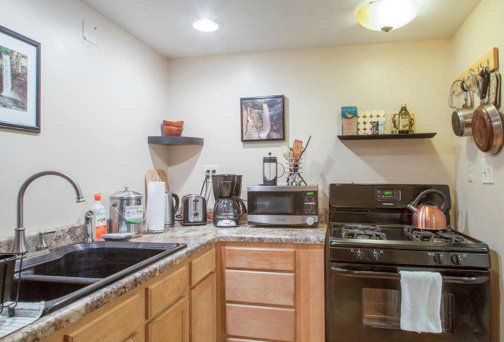 Full, updated kitchen w/ coffee & basic breakfast foods, dishes, cookware, utensils