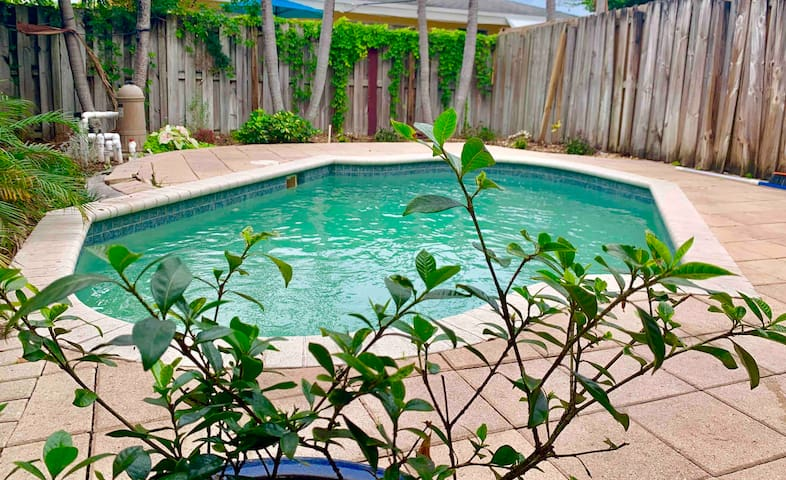 Private Room with pool close to shops & beach!