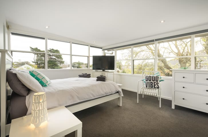 Upstairs bedroom with Queen and 3 singles (TV and DVD)