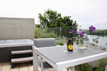 Enjoy the hot tub, whilst watching the moving view on the water and of course sipping a glass of fizz!