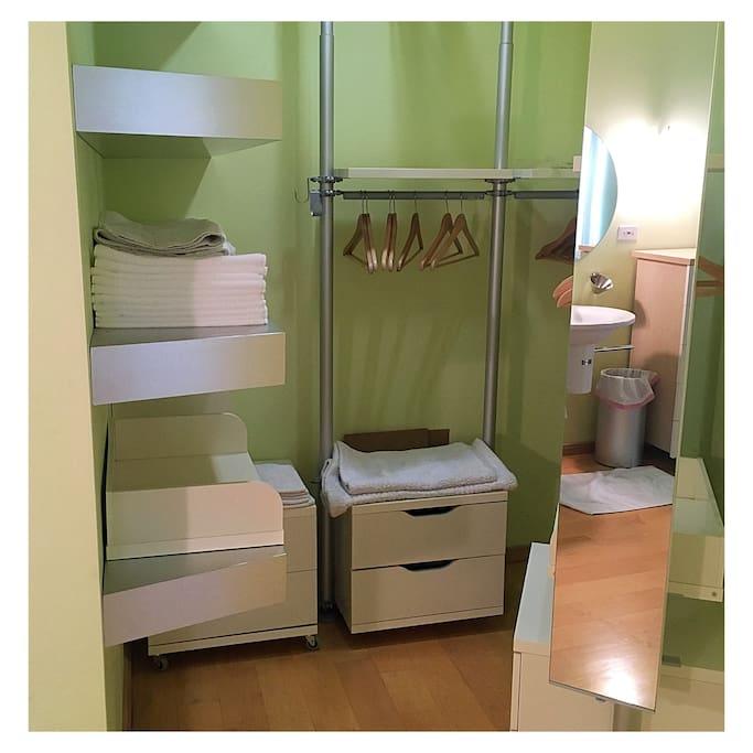 Towels & hangers in closet.
