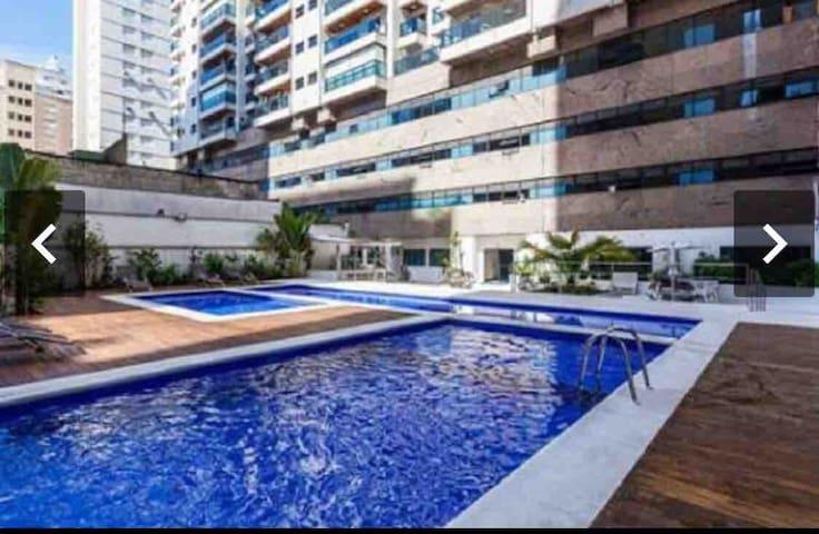 Apartamento flat Guarujá 2 dorm suite 1111