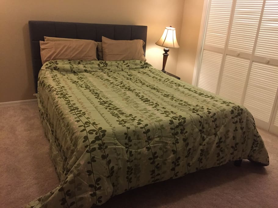 Cozy queen size bed with memory foam mattress