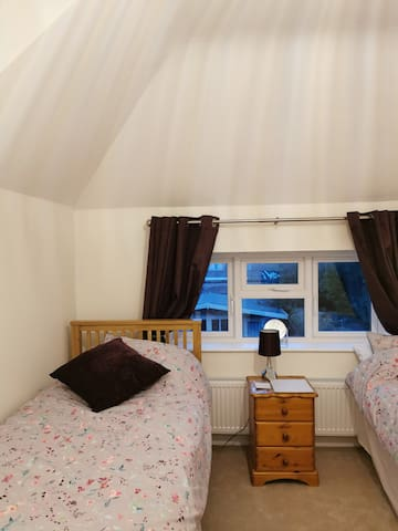 Twin bedroom with ensuite and TV