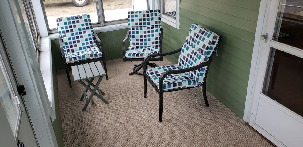 Front Porch for seating outside in screen room, also can slide windows down in the cooler Season.