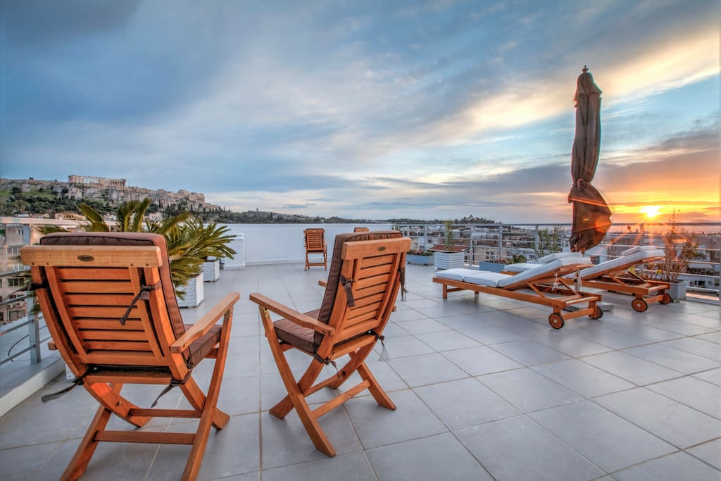 Large private Terrace overlooking Acropolis and the Parthenon with magnificent sunset view