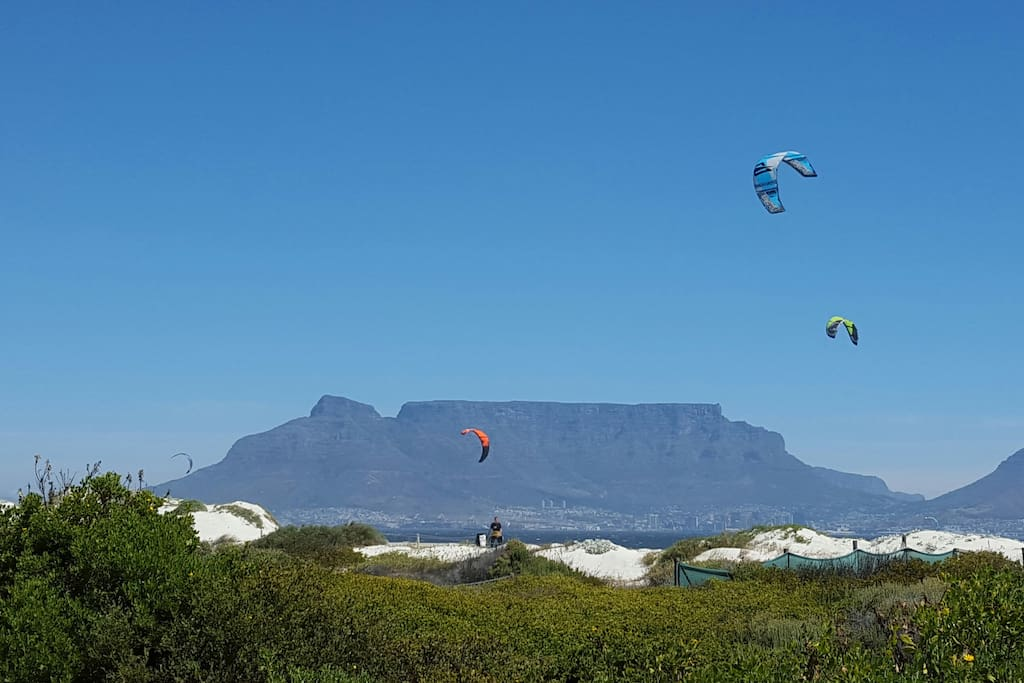 Kite surfers with a view of Table Mountain