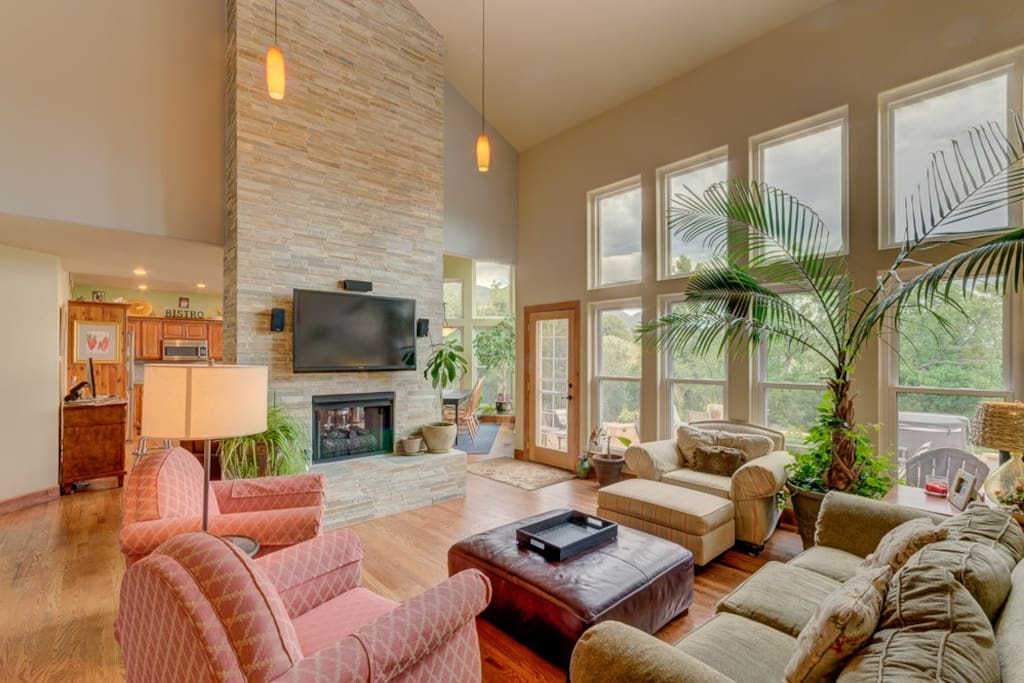 Family room has great views with wall of windows, 2 story stone fireplace, cable TV, dvd player and plenty of seating in this open floor plan.