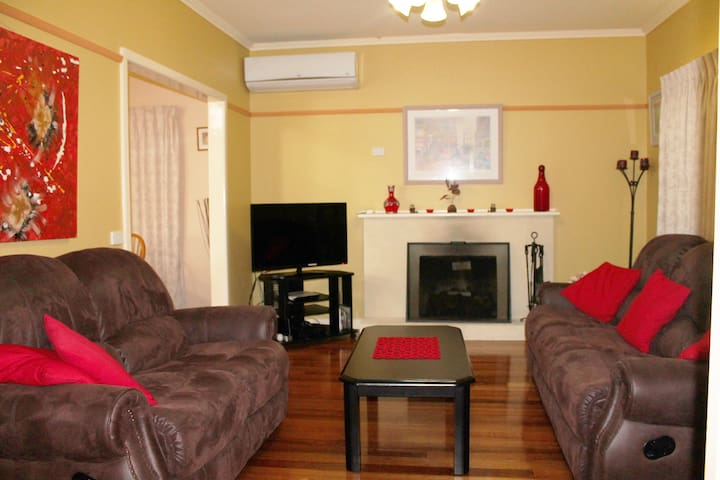 Lounge with fireplace, flat screen T.V and aircon.