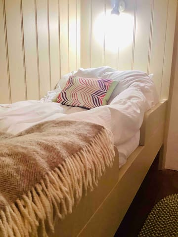 Twin room.  Full size bunk beds, super comfortable.  Wooden floor with rugs.