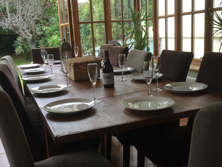 The large kitchen table that overlooks the mature west facing garden with its two extensions can accommodate 16 diners for a convivial meal