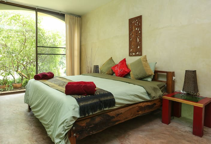 King Size traditional wooden bed with lovely Garden views