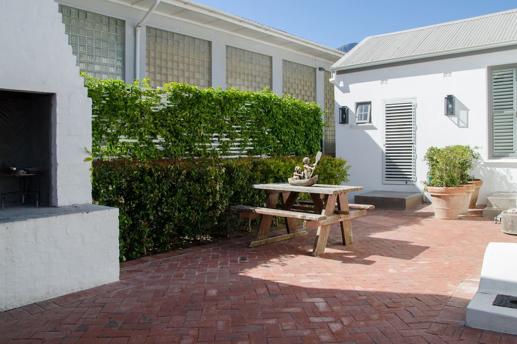 The cottage entrance and outdoor barbecue area