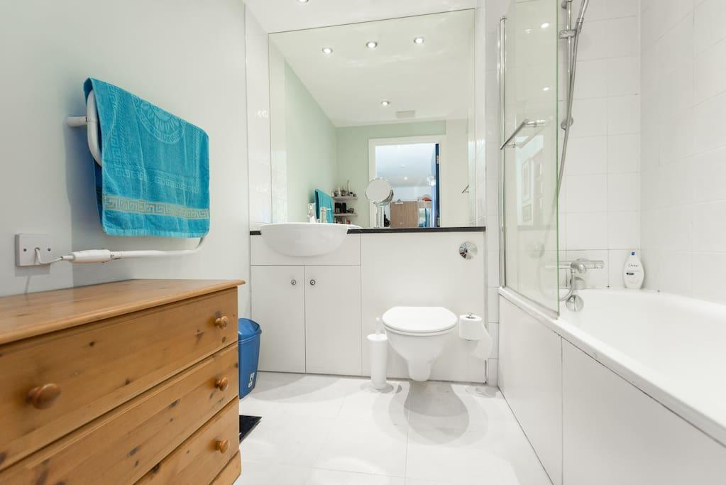 bathroom has bath and shower