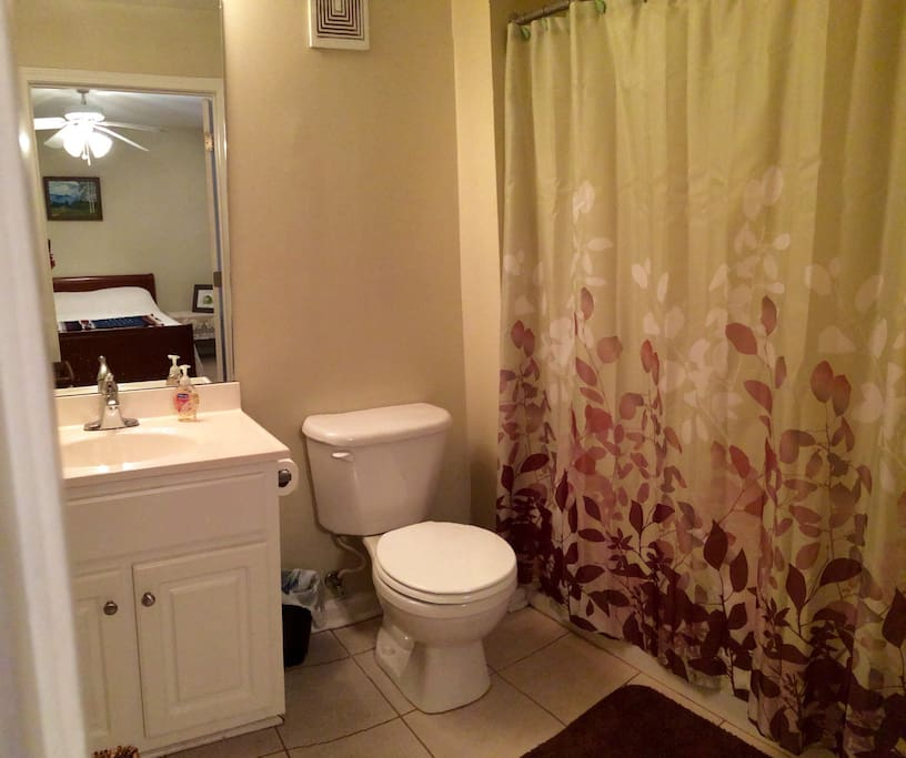Accessible en-suite bathroom stocked with toiletries and towels.