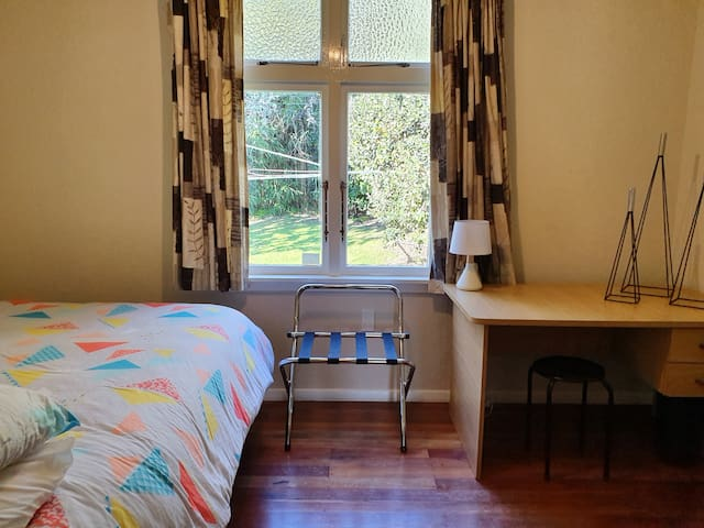 A brand new double bed with fresh new sheets, 2x good quality comfortable pillows, duvets and blankets if needed.  The room has a  luggage rack, dresser mirror, cupboard, drawer chest dresser,  and desk.