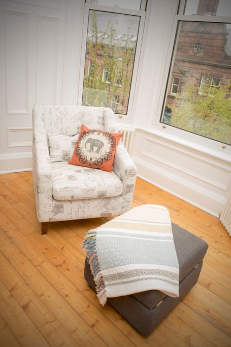 Comfy armchair to watch the world go by.