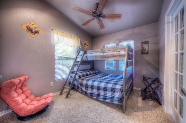 Third bedroom with full bed on the bottom and twin bed up top