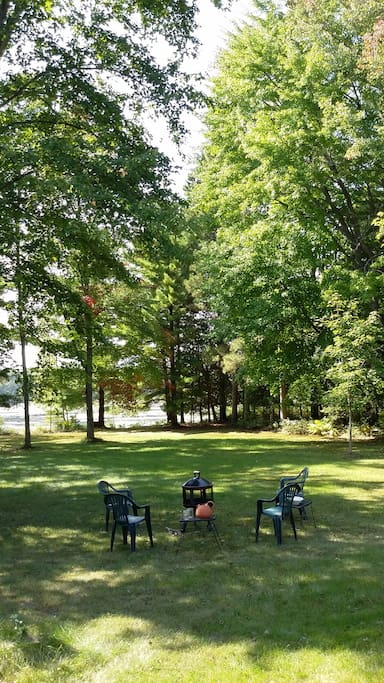 Enjoy the large wooded lawn over looking the water.