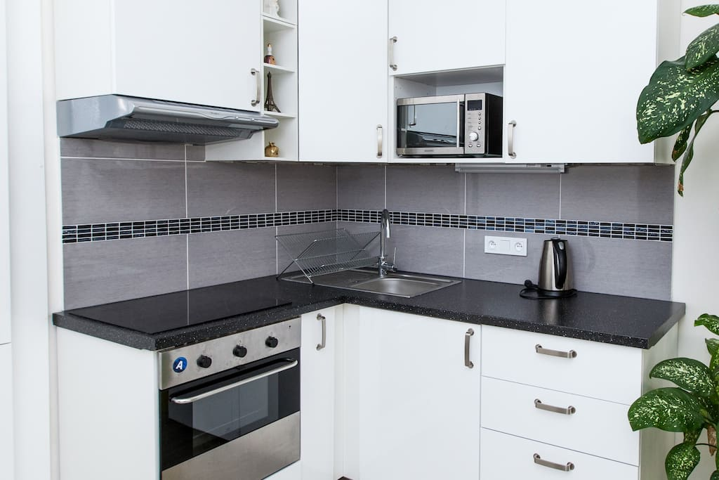 Kitchen with hob, microwave, kettle