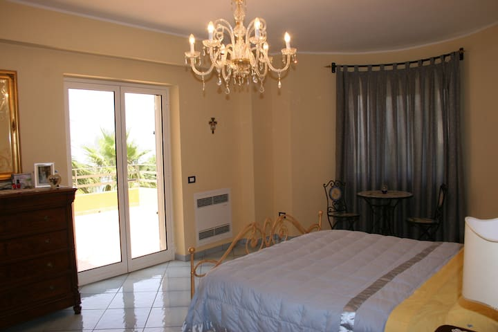 Master Bedroom facing the Mediterranean with large Patio