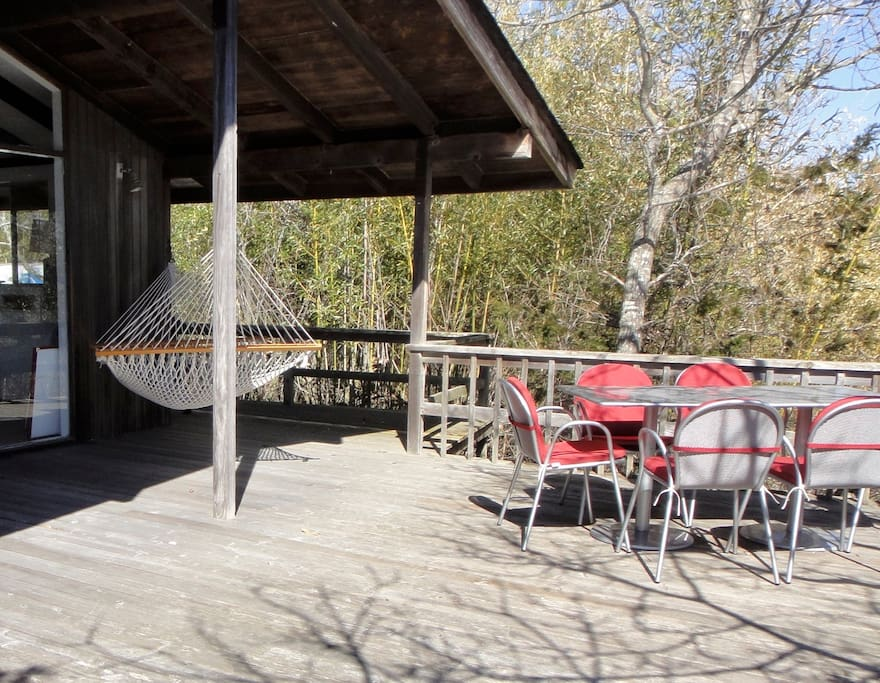 The deck offers outdoor seating for dining and relaxing. The hammock is definitely a fav spot!