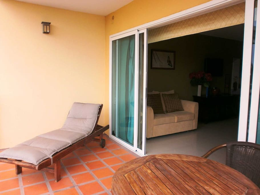 Balcony of studio room with lounge and 2-seat dining table