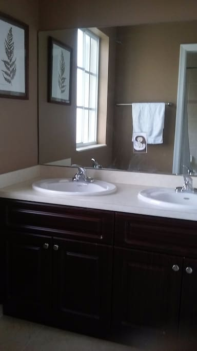 Private bathroom with double sink.
