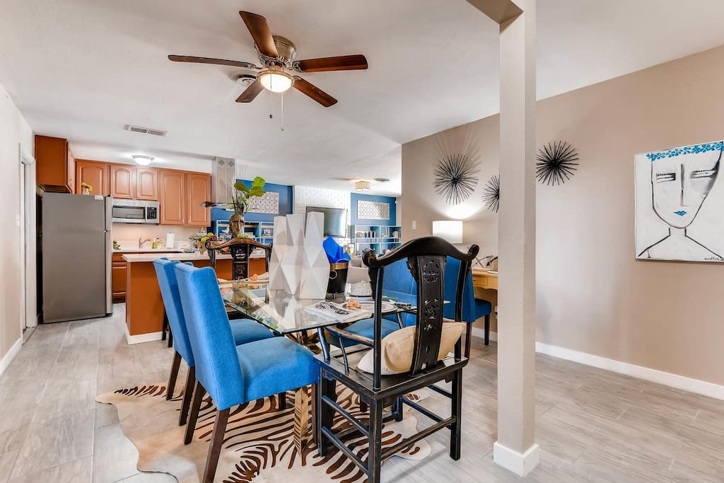"Touches of blue bring the dining area to life. It's perfect for ""at home"" meals."