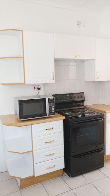 Kitchen with stove,microwave