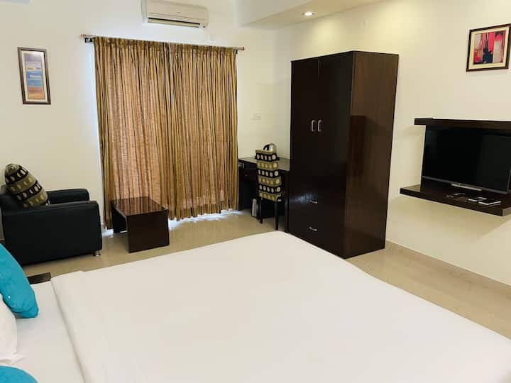 Airy Room w Balcony + Smart TV at Sanctum Domlur