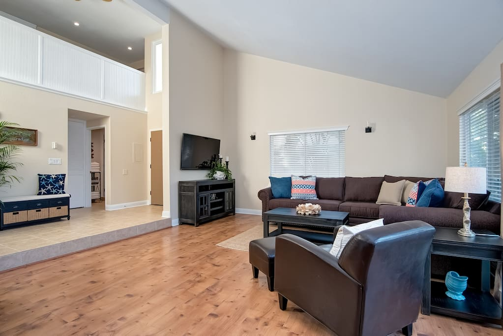 Comfortable living room includes a flat screen HD TV. The couch also pulls out into a queen size sleeper sofa.
