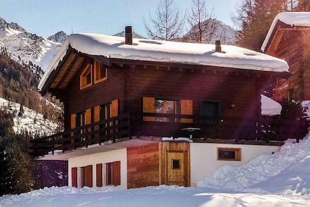 Chalet Les Marmottes, chaleureux, ski-room, sauna.