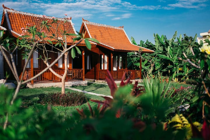 Wooden house with rice field view in canggu