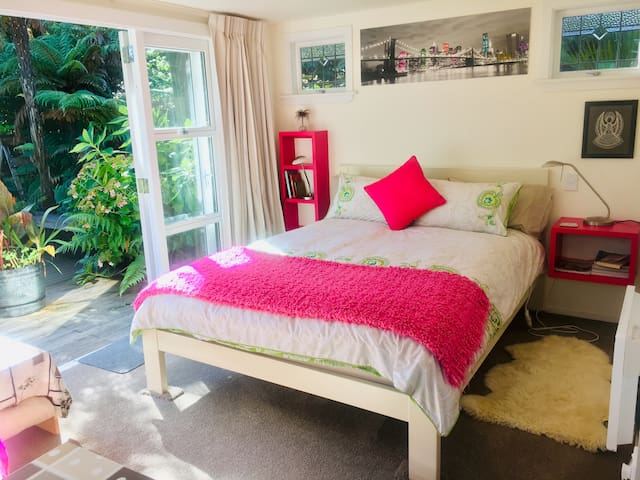 Luxury queen size bed, linen, blankets. Bedside reading lights, plenty of power points. Access to private patio