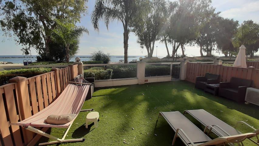 Beachfront ground floor apartment, private yard